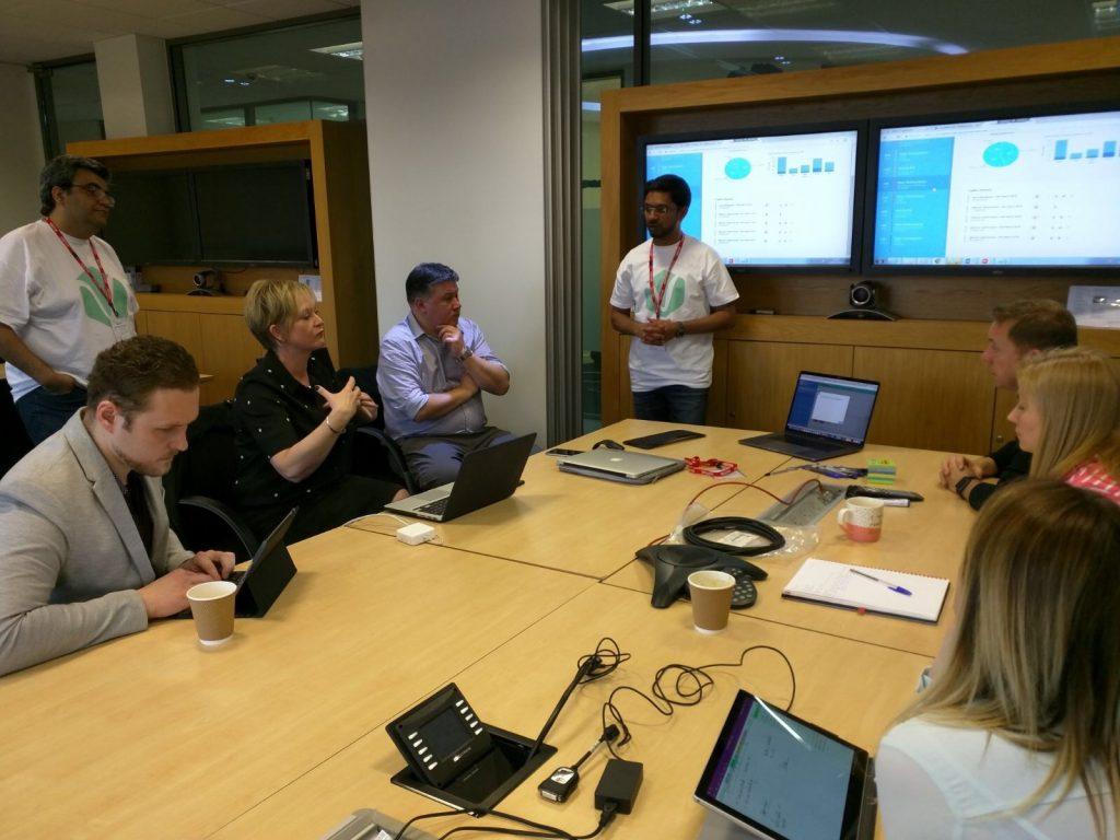 Amila presenting at a meeting